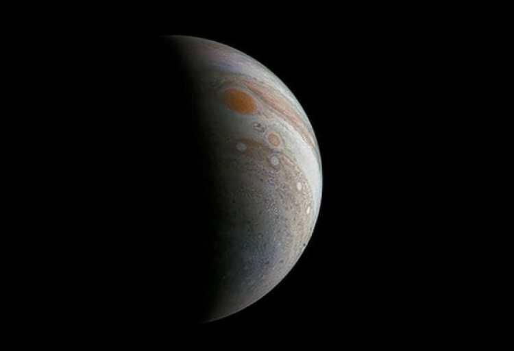 Vista de Júpiter con la Gran Mancha Roja en alto (AFP PHOTO / NASA)