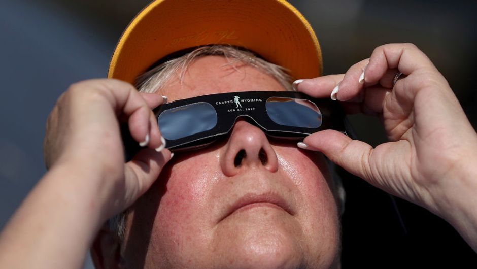 CASPER, WY - AUGUST 21: A visitor looks at the solar eclipse at South Mike Sedar Park on August 21, 2017 in Casper, Wyoming. Millions of people have flocked to areas of the U.S. that are in the