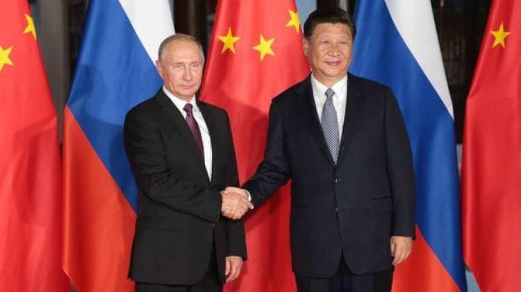 Vladimir Putín yXi Jinping en la cumbre de BRICS el 3 de septiembre de 2017