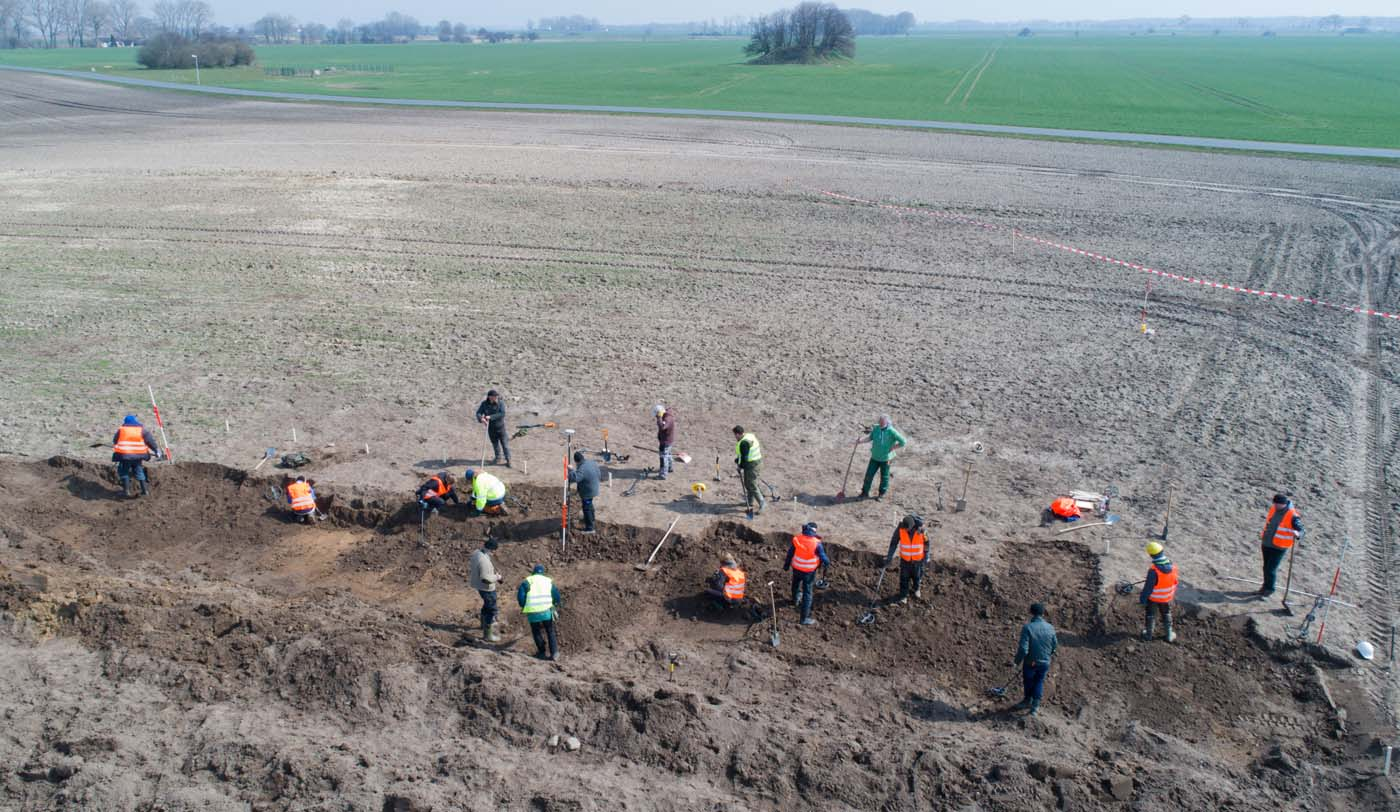 "This aerial picture taken with a drone on April 13, 2018 shows archaeologists looking for a treasure in Schaprode, northern Germany. A 13-year-old boy and a hobby archaeologist have unearthed a ""significant"" trove in Germany which may have belonged to the legendary Danish king Harald Bluetooth who brought Christianity to Denmark. A dig covering 400 square metres (4,300 square feet) that finally started over the weekend by the regional archaeology service has since uncovered a trove believed linked to the Danish king who reigned from around 958 to 986. Braided necklaces, pearls, brooches, a Thor"