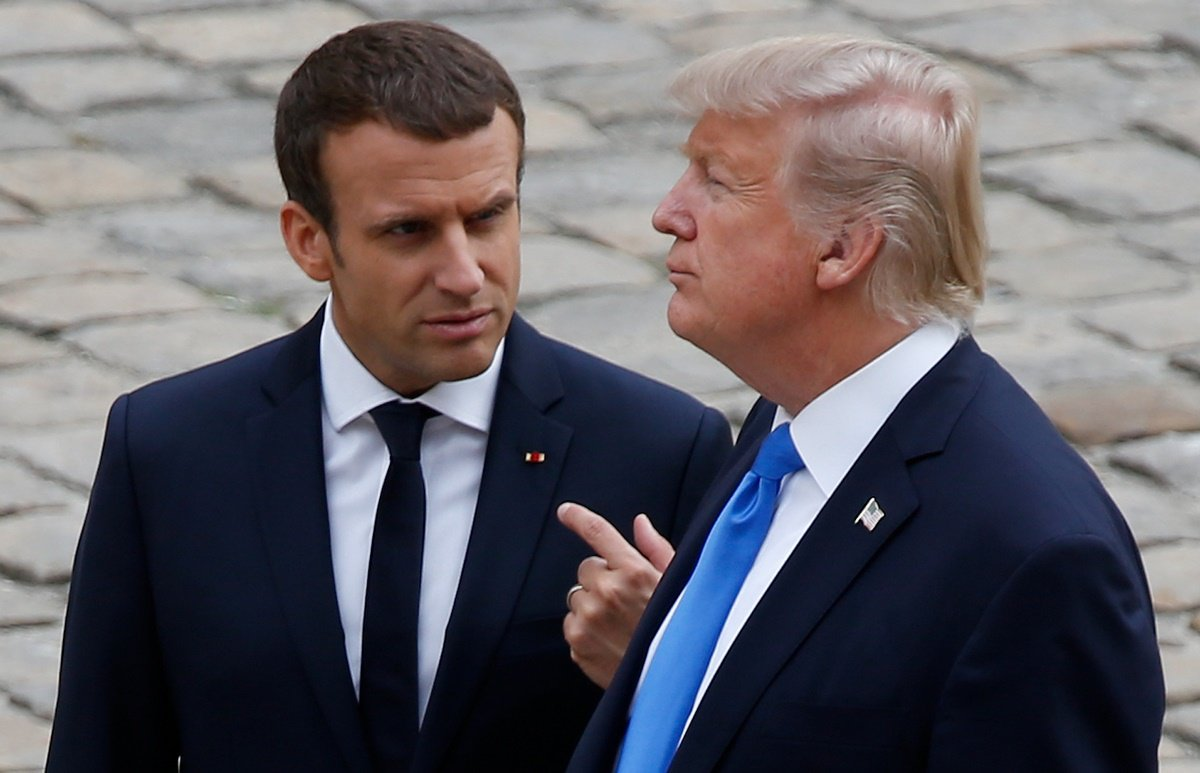 French President Emmanuel Macron and U.S. President Donald Trump walk in the courtyard as they leave after a welcoming ceremony at the Invalides in Paris, France, July 13, 2017. REUTERS/Charles Platiau