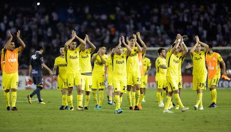 Jugadores de Boca celebran el empate conseguido ante Junior