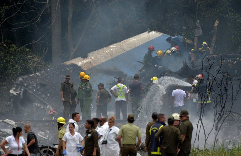 Emergency personnel work at the site of the accident after a Cubana de Aviacion aircraft crashed after taking off from Havana