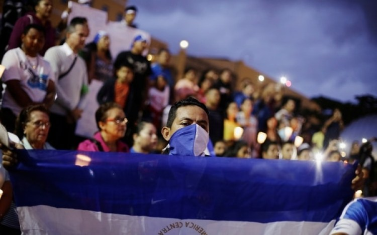People in support of Nicaraguan protesters who are opposing Nicaraguan President Daniel Ortega, rally at the La Democracia square in San Jose, Costa Rica August 11,2018. REUTERS/Juan Carlos Ulate