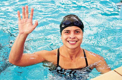 Karen con el brazo derecho en alto después de una competencia. Foto: Pedro Laguna
