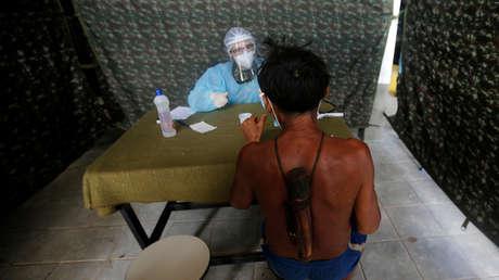 Vacunación a cambio de oro: cómo los mineros ilegales de Brasil bloquean el acceso a las vacunas de los indígenas Yanomami