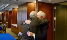 Larry Lustberg shares an embrace with Judge Gibbons