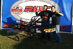 Dylan Zobkiw, who just relocated to Charlotte, N.C, celebrates his Senior Pro Gas Animal national championship and new Coyote ZP with Jim Lipari (NCRM photo)