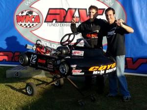 Dylan Zobkiw (left) celebrates his 2013 Senior Pro Gas Animal championship and new go-kart with Coyote's Jim Lipari (Photo: NCRM)