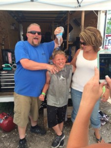 Eli Fox (center) gets a victory shower courtesy of dad Jamie and mom Morgan Fox at Brazil (IN) (Photo: Jamie Fox)