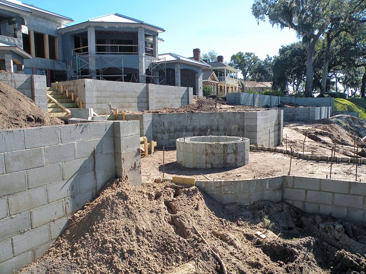 Masonry block tiered retaining walls and walkway.