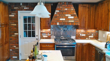 Custom masonry brick hood and kitchen back splash.