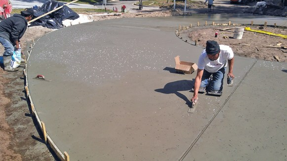 Installation of a salt crystal finish driveway.