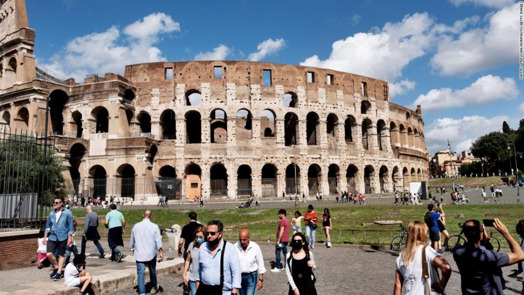 Groups of tourists in front of the Rome's Colosseum on June 14.