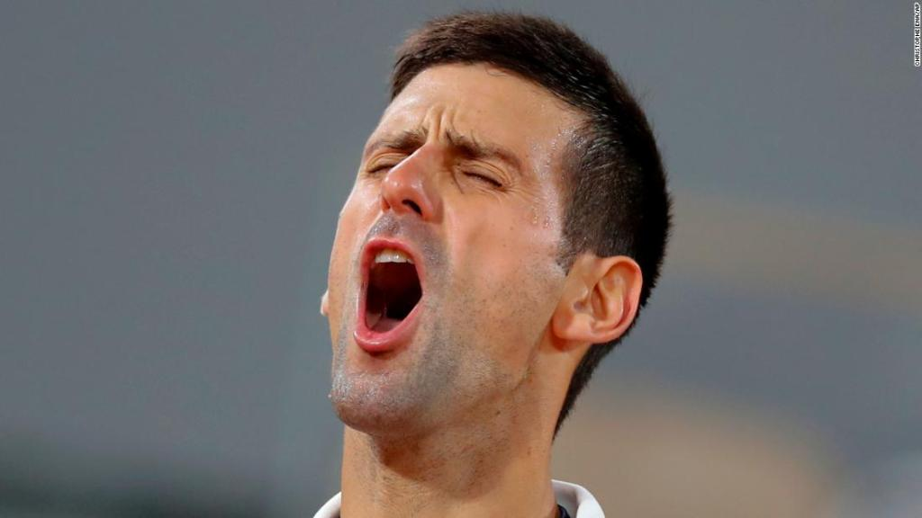 Novak Djokovic plays through pain to reach French Open semifinals