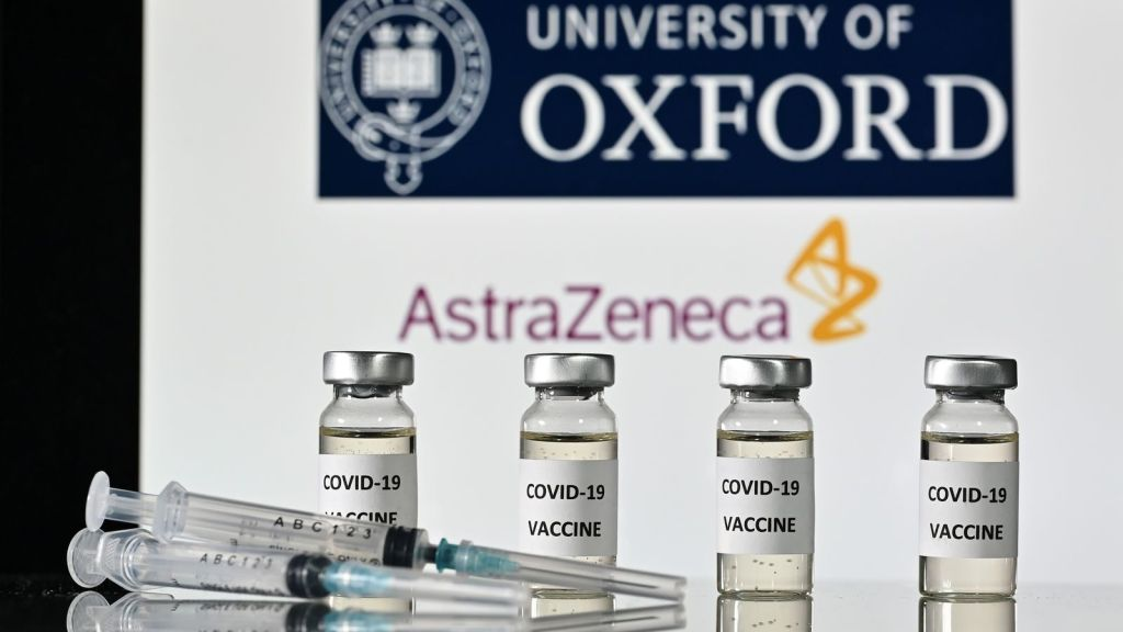 An illustration picture shows vials with Covid-19 Vaccine stickers attached and syringes, with the logo of the University of Oxford and its partner British pharmaceutical company AstraZeneca, on November 17, 2020. (Photo by JUSTIN TALLIS / AFP) (Photo by JUSTIN TALLIS/AFP via Getty Images)