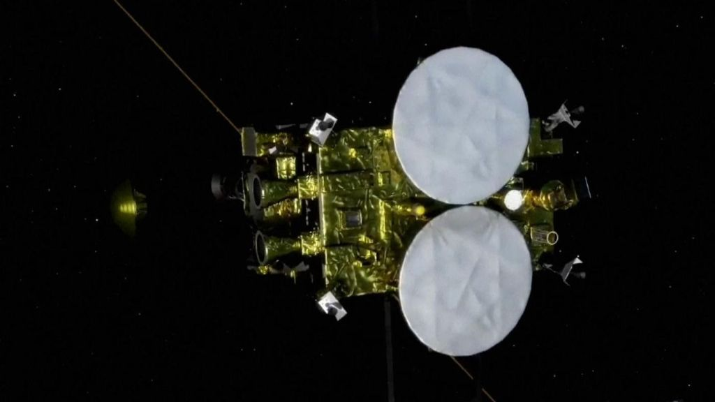 The capsule (the light to the left of the spacecraft) detaches in a simulation. Pic: JAXA