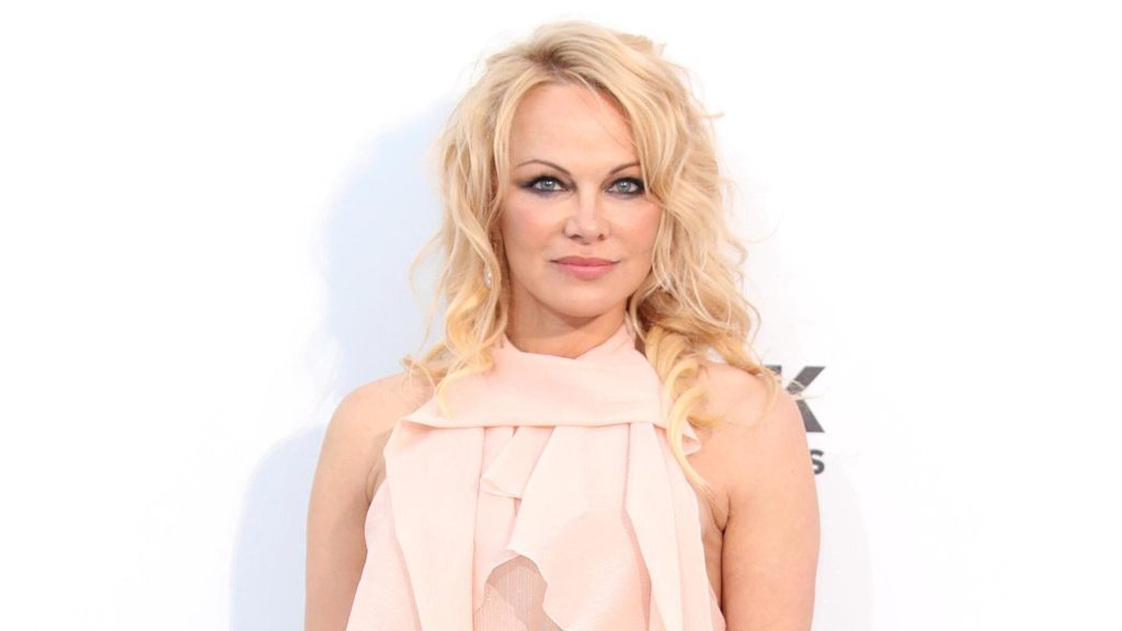 Pamela Anderson posts topless throwback photo to lament missing the warm weather