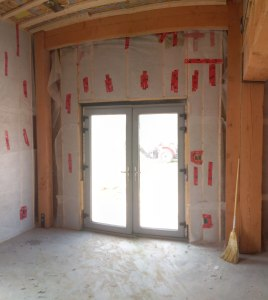 Blown cellulose insulation around doors
