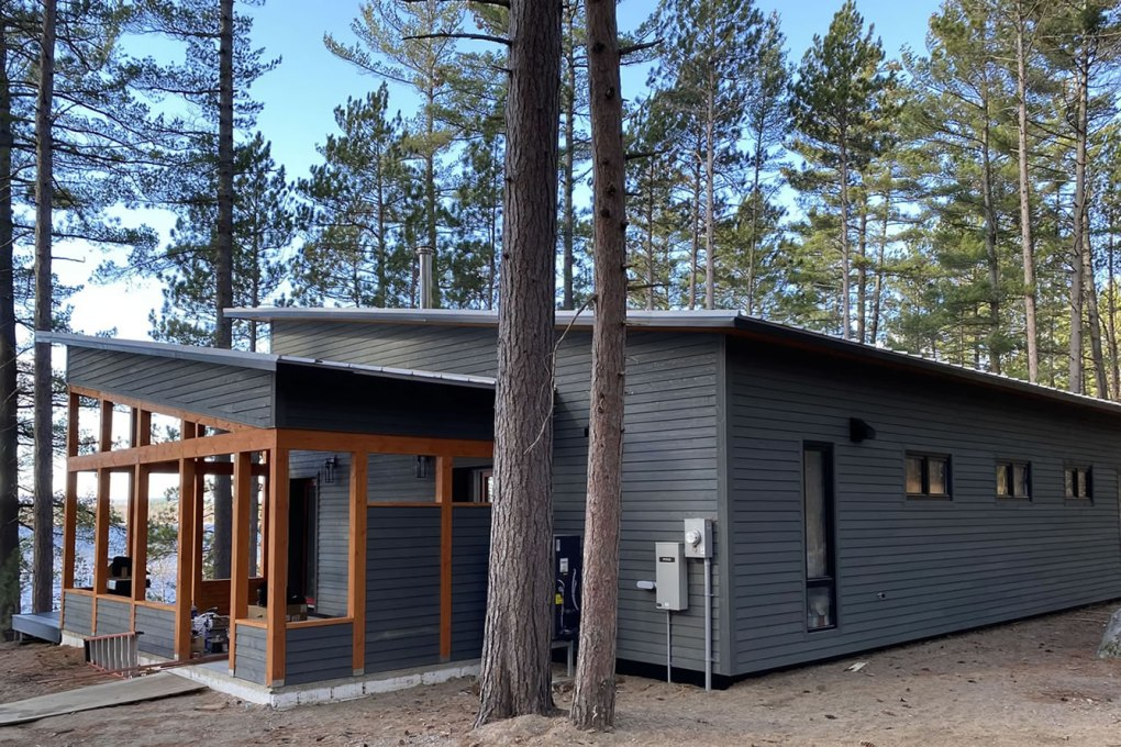 Beautiful lakeside home built with EkoBuilt's Hummingbird plan - click to see all energy efficient home plans.