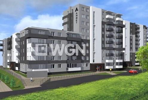 widok z zewnątrz na ekskluzywny apartamentowiec w Olsztynie, w którym znajduje się luksusowy apartament na sprzedaż