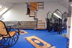 widok z innej perspektywy na salon w ekskluzywnym apartamencie do wynajęcia w Kwidzynie