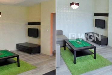na zdjęciach salon widziany z dwóch różnych perspektyw w luksusowym apartamencie do wynajmu w Piotrkowie Trybunalskim