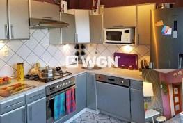 zdjęcie prezentuje komfortową kuchnię w apartamencie na sprzedaż w okolicach Katowic
