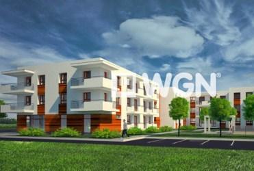 widok od strony osiedla na apartamentowiec w Warszawie, gdzie mieści się oferowany do sprzedaży apartament