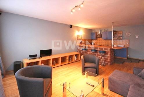 na zdjęciu komfortowe i nowoczesne wnętrze luksusowego apartamentu do wynajmu w Szczecinie