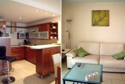 po lewej aneks kuchenny po prawej salon w komfortowym apartamencie we Wrocławiu do wynajmu