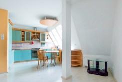 widok na kuchnię w ekskluzywnym apartamencie w Szczecinie na sprzedaż