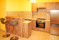 widok na komfortowy aneks kuchenny w ekskluzywnym apartamencie do wynajmu w Inowrocławiu