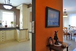 fragment komfortowego wnętrza z kuchnią i jadalnią w luksusowej willi do sprzedaży w okolicach Słupska