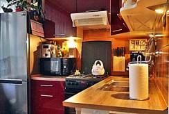 stylowo umeblowana oraz urządzona kuchnia w luksusowym apartamencie w Białymstoku na sprzedaż