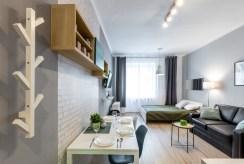 widok na jedno z luksusowo wyposażonych pomieszczeń w ekskluzywnym apartamencie w Krakowie na sprzedaż