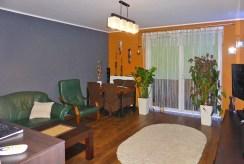 na zdjęciu stylowy salon w ekskluzywnym apartamencie do sprzedaży w Kwidzynie
