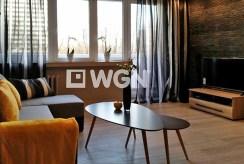 widok na salon oraz taras w luksusowym apartamencie do wynajmu w Katowicach