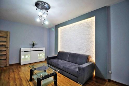 wytworny salon w ekskluzywnym apartamencie do wynajęcia w Krakowie