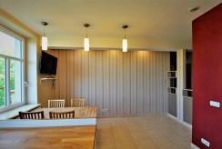 na zdjęciu stylowa kuchnia z jadalnią w luksusowym apartamencie w Krakowie na wynajem