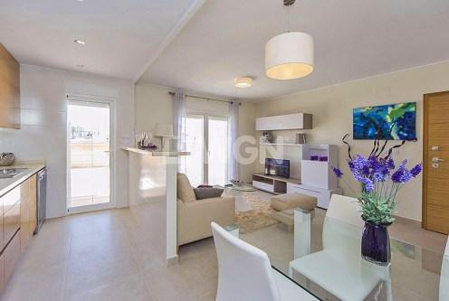 zaprojektowany w nowoczesnym designie salon w luksusowym apartamencie do sprzedaży Hiszpania (Costa Blanca, Orihuela Costa, Punta Prima)