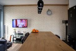 widok na salon w luksusowym apartamencie do sprzedaży Konin