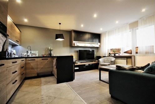 przestronny salon w ekskluzywnym apartamencie do sprzedaży Kraków
