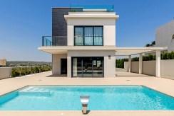 widok od strony basenu na luksusową rezydencję do sprzedaży Hiszpania (Campoamo)