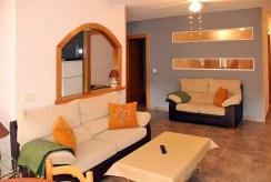 widok na pokój dzienny w ekskluzywnym apartamencie do sprzedaży Hiszpania (Costa Blanca, Orihuela Costa)