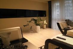widok z innej perspektywy na luksusowy salon w ekskluzywnym apartamencie do wynajmu Częstochowa