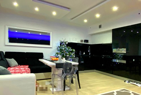 nowoczesne oświetlenie salonie ekskluzywnego apartamentu do sprzedaży Szczecin