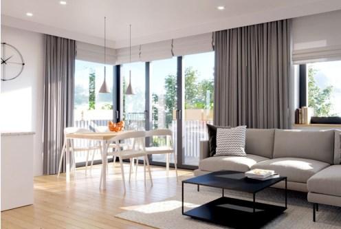 słoneczny salon w ekskluzywnym apartamencie do sprzedaży Myszków