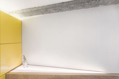 a-triangular-addition-with-a-light-box-was-inserted-behind-the-sofa-to-align-the-living-space-with-the-angled-tv-wall