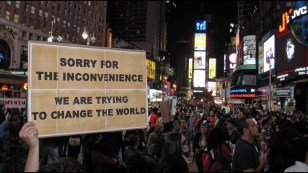 change-the-world-sign-from-ows-879x496